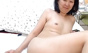 elderly Oriental milf plays to snatch