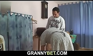 70 seniority mom enjoys riding his juvenile cock