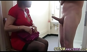 Clothed milf gives head