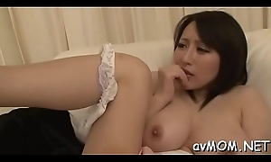 Sexy oriental materfamilias undresses and her tight cookie finger fucked